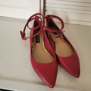 Bright pink Juicy Couture flats